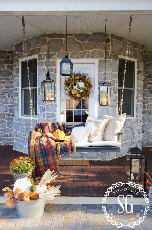 Beautiful porch swing and decor from Stone Gable