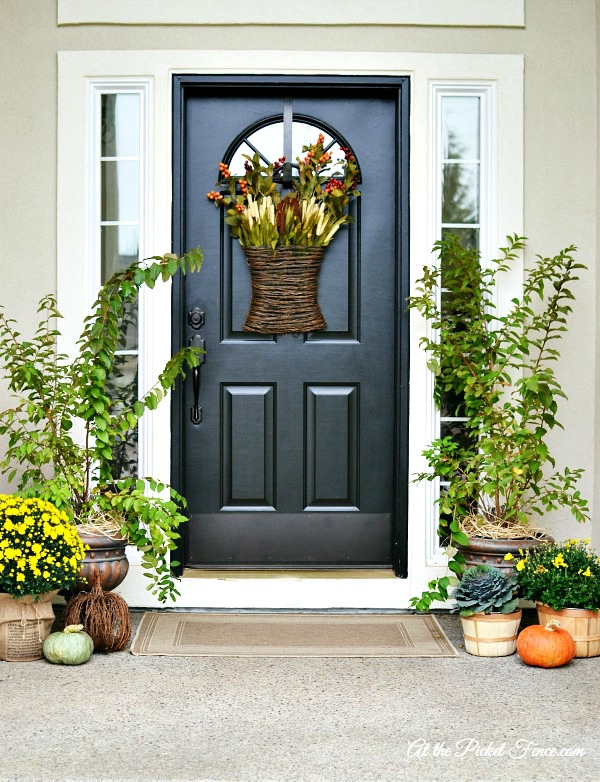 Pretty fall front porch from At the Picket Fence