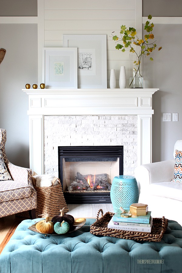Fall fireplace with pretty art prints from The Inspired Room
