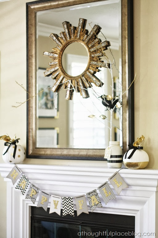 Black and white with pops of gold for a fall mantel from A Thoughtful Place