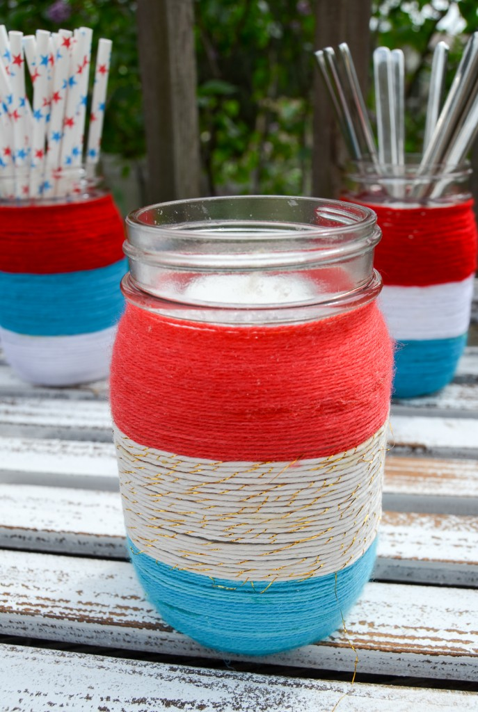 Patriotic yarn wrapped Mason jars. Perfect for summer entertaining and/or the Fourth of July.