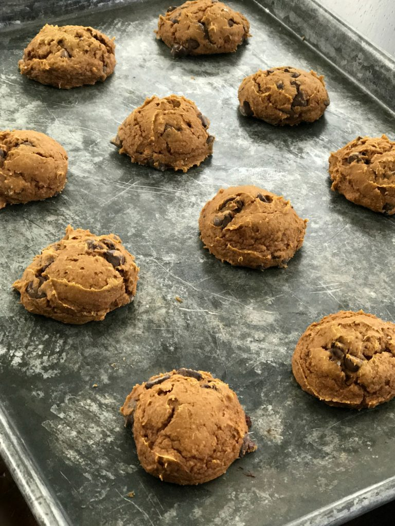 Moist + delicious THREE ingredient pumpkin chocolate chip cookies. Perfect for fall. #fall #fallbaking #pumpkin #pumpkinspice #chocolatechipcookie #cookie
