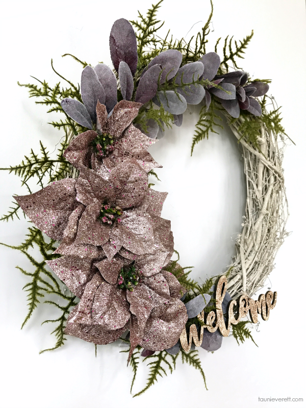 Winter Welcome Wreath. This easy to create poinsettia wreath is perfect for the holidays through January! #christmaswreath #winterwreath #wreath #poinsettiawreath