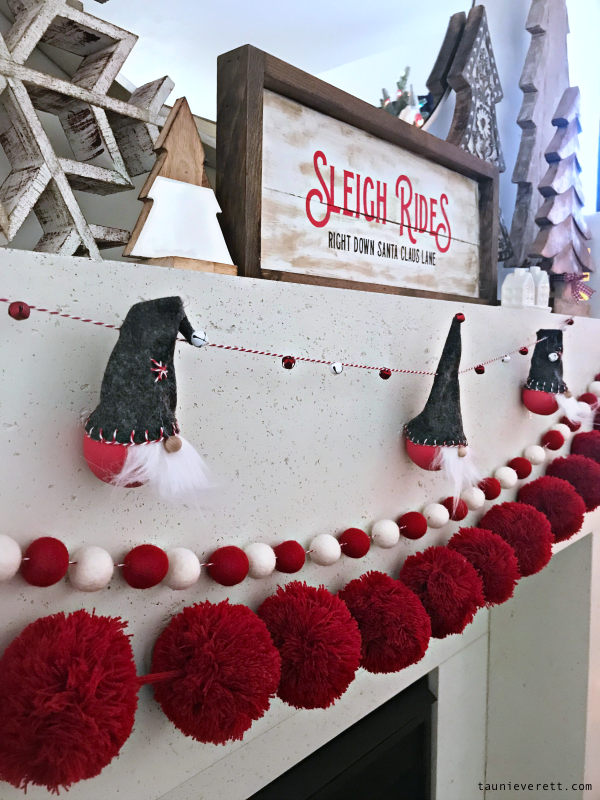 Red and white Christmas mantel with wood trees and gnomes #christmas #christmasmantel #redwhitechristmas #christmasdecor #gnomes #christmasgnomes