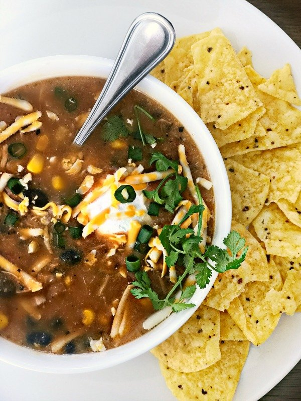 Instant Pot Eight Can Taco Soup. Make this hearty, crowd pleaser in 10 minutes! #instantpot #soup #instantpotsoup #tacosoup #mexican