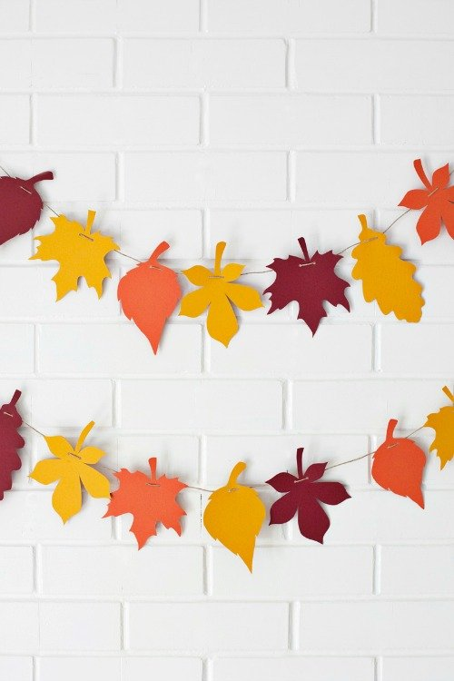 Simple fall leaf garland. Have kids cut leaves out of cardstock and thread them with yarn.