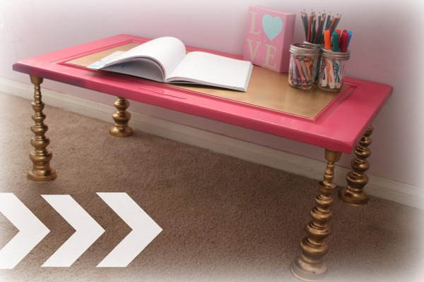 Child's desk made from candlesticks and cupboard door