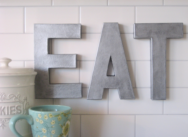 DIY galvanized EAT sign for the kitchen. I love how easy this tutorial is and how light weight the letters actually are.