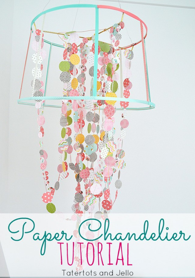 Paper chandelier made with circles punched out of scrapbook paper, ribbon and wire frame.