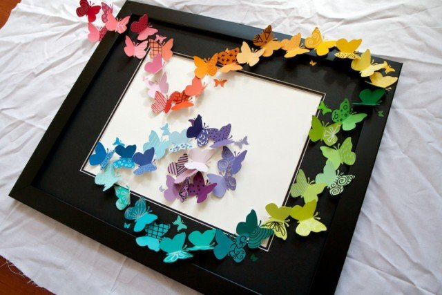 Butterfly wall art made out of scrapbook paper butterflies