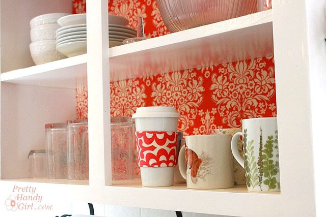 Fabric backed kitchen shelves. This adds such a big, bright, beautiful pop of color to the kitchen.